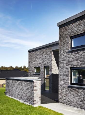 Zink inddækning og sternbeklædning på et funkis hus
